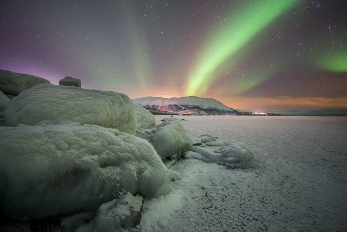 Northern lights in Abisko, Sweden at the lake Torneträsk